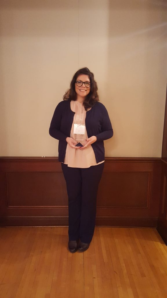 Photo of Julie Di Biasio holding the 2017 L. Scott Lissner - Outstanding Leadership Award